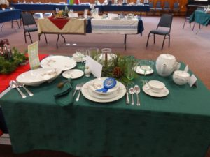 "Cheryl Schutz won a blue ribbon for her table ""Dinner for John & Priscilla Larchmont"""