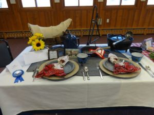 "Julie Farnham created this ""Cowboy Vittles"" table which won a blue ribbon and came in second for best of show."